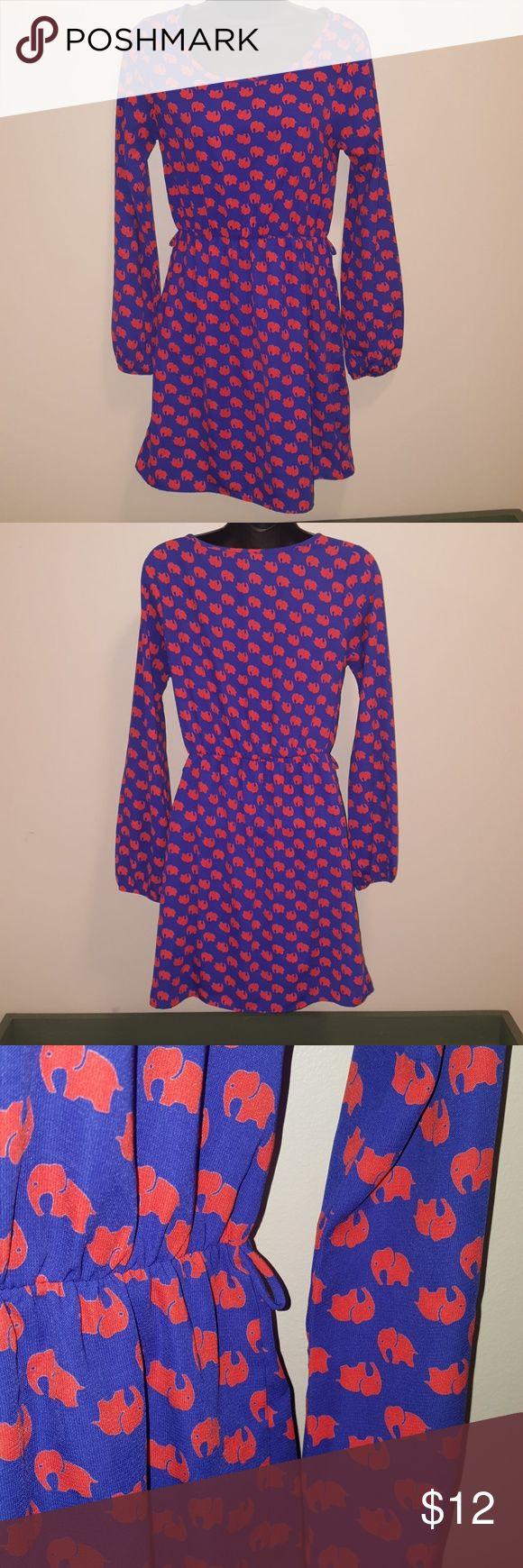 Cute Elephany pattern Everly dress small Love the pattern of this like new condition long sleeve Everly small elephant pattern dress. 100% polyester shell and lined. The waiste is elastic as well as the sleeves at the wrist. Please be aware that it is missing the belt. Everly Dresses Mini