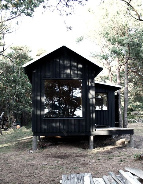 Ermitage Cabin by SEPTEMBRE. Black, wood, large windows