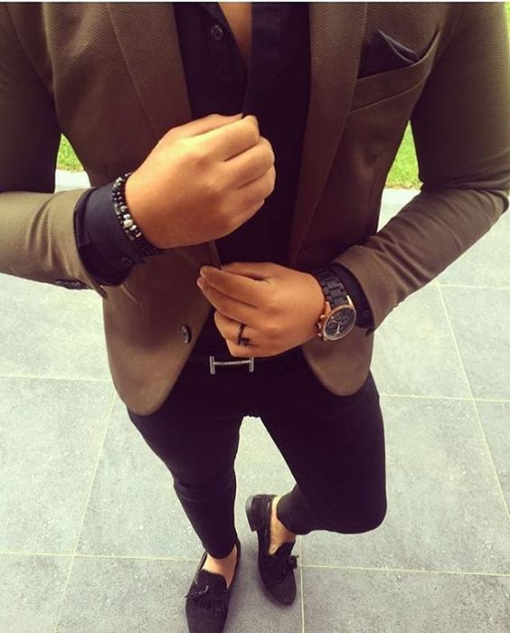 Consider teaming a brown blazer jacket with black slim jeans to achieve a dressy but not too dressy look. Take a classic approach with the footwear and make black suede tassel loafers your footwear choice.   Shop this look on Lookastic: https://lookastic.com/men/looks/blazer-dress-shirt-skinny-jeans/24011   — Brown Blazer  — Black Pocket Square  — Black Dress Shirt  — Black Bracelet  — Black Watch  — Black Leather Watch  — Black Skinny Jeans  — Black Suede Tassel Loafers