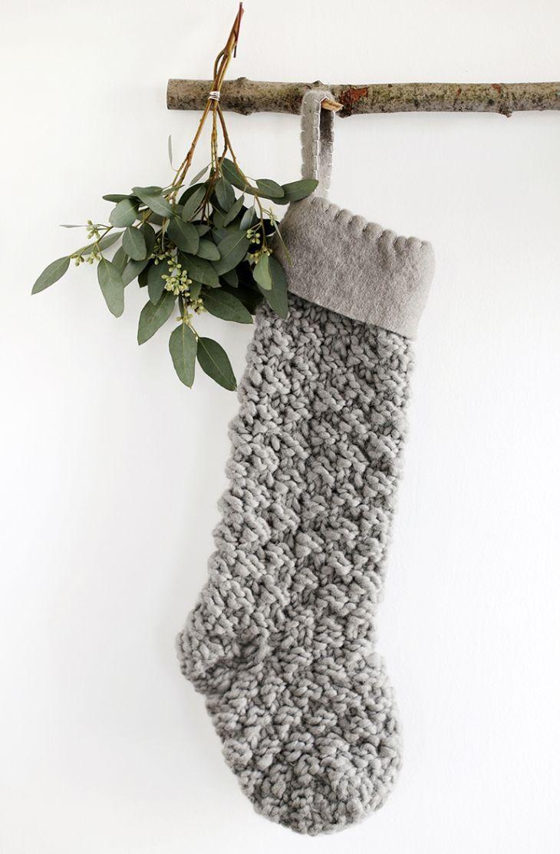 ... DIY branch stocking display (items West Elm http://www.westelm.com/) ...