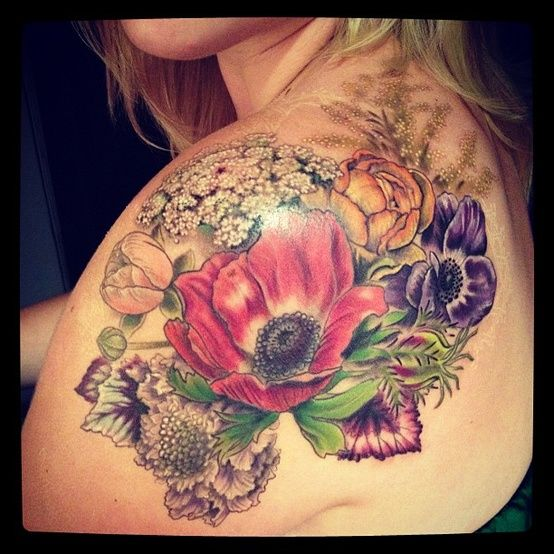 See more Flower's bouquet tattoo on back