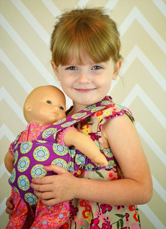 Free pattern for doll carrier and other tutorials about dolls - (I made this. It was not a short project, but it is cute and the directions were clear. Next time, I would likely spend my time making a carrier that looks more like mama's. ~N)