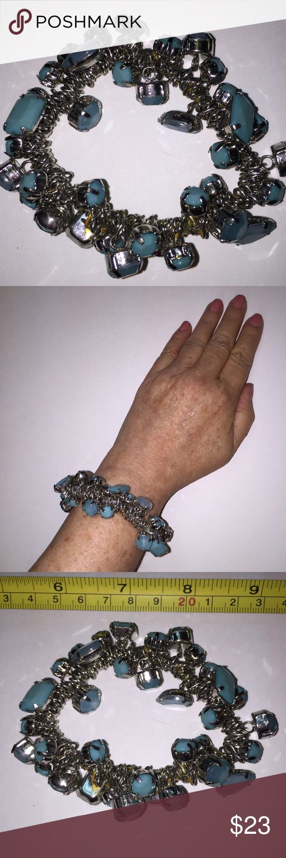 Vint Fun Noisy Faux Turquoise & Silver Tone Stre Vintage Fun Noisy Faux Turquoise & Silver Tone stretch bracelet. Light weight. Size small to medium/large fits most.  Very Feminine. Great Christmas gift or stocking stuffer. Accessorize Jeans or dressy outfit. Price is firm please. Vintage Jewelry Bracelets
