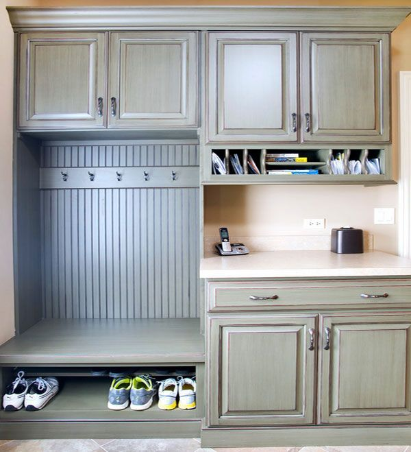 Like the color combinations, john-hall-homes-wood-cabinet-charging-station-and-shoe-rack