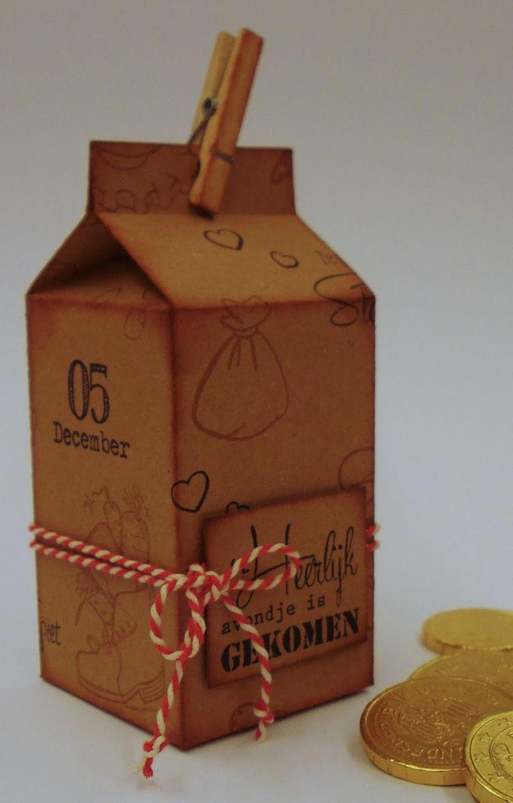 Marjoleine's blog: Nog meer Sinterklaas-creaties - Melkpakje om kadootjes in te doen. In dit blogbericht vind je een link naar het patroon van het melkpakje. Het karton, dat hier gebruikt is, is bestempeld met een sint en piet stempel.