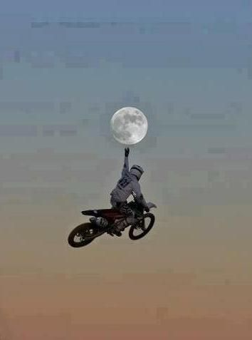 ...Almost ........... there ......   Bike Rider touching the moon.