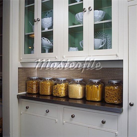 Sage Green Kitchen Storage Jars: Grass Cloth Backsplash