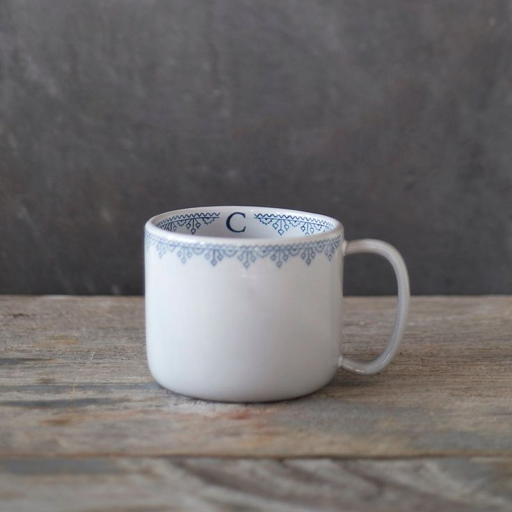 """Designed and hand-crafted exclusively for terrain, this cozy mug is our very first creation with Doe Run Pottery. A Scandinavian-inspired border surrounds each mug, with a simple monogram tucked inside.- A terrain exclusive- Glazed stoneware- Dishwasher and microwave safe- Handle: 2.25""""H, 1.5""""W- Imported3""""H, 3.6""""W with handle, 2.5"""" diameter"""