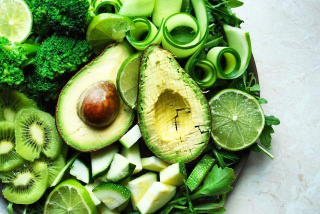 Vegan green salad bowl with avocado, cucumber, zucchini, kiwi, broccoli, lime