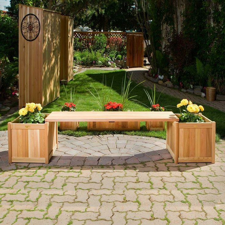 Two Planters And A Bench Combine To Create A Functional