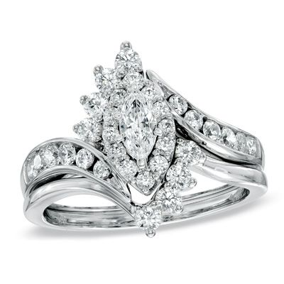 The engagement ring features beautifully crafted bypassing ribbons of 14K white gold set with shimmering diamonds.