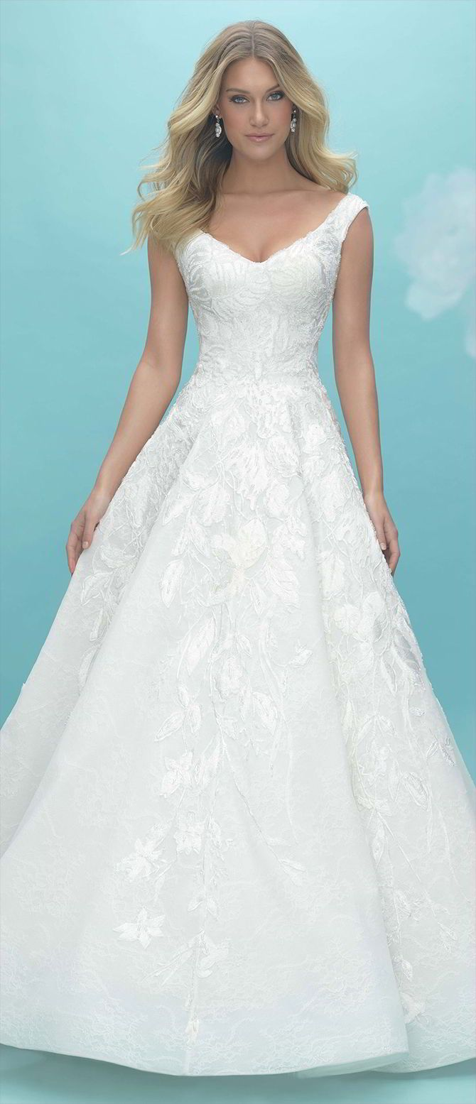 Multiple delicate textures, accented with shimmering beadwork, add subtle charm to this timeless ballgown.