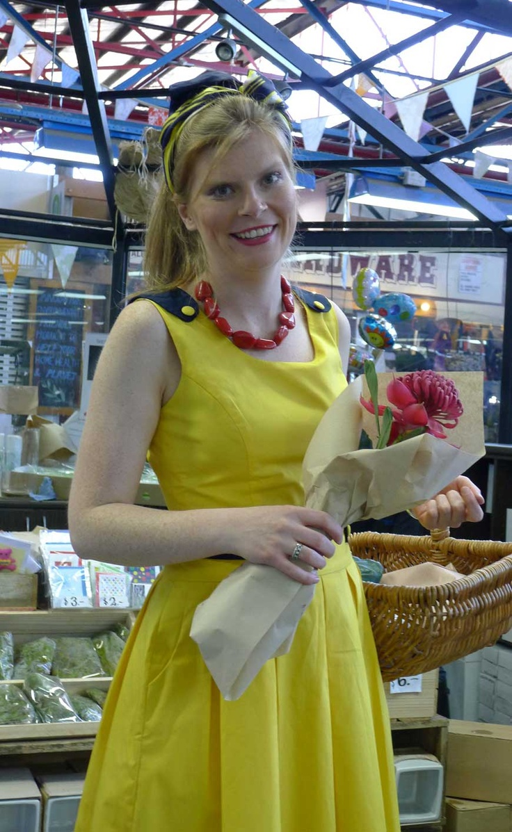 Off to buy flowers in a yellow pleated summer dress.