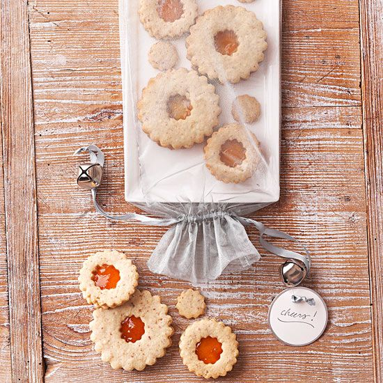 Pretty Wrapped Platter. Almond and nutmeg cookies feel holiday-perfect when stuffed with apricot jam and placed on a narrow rectangular platter. Slide the platter into a pretty silver wine-bottle gift bag, and include jingle bells on the strings for a merry gift.