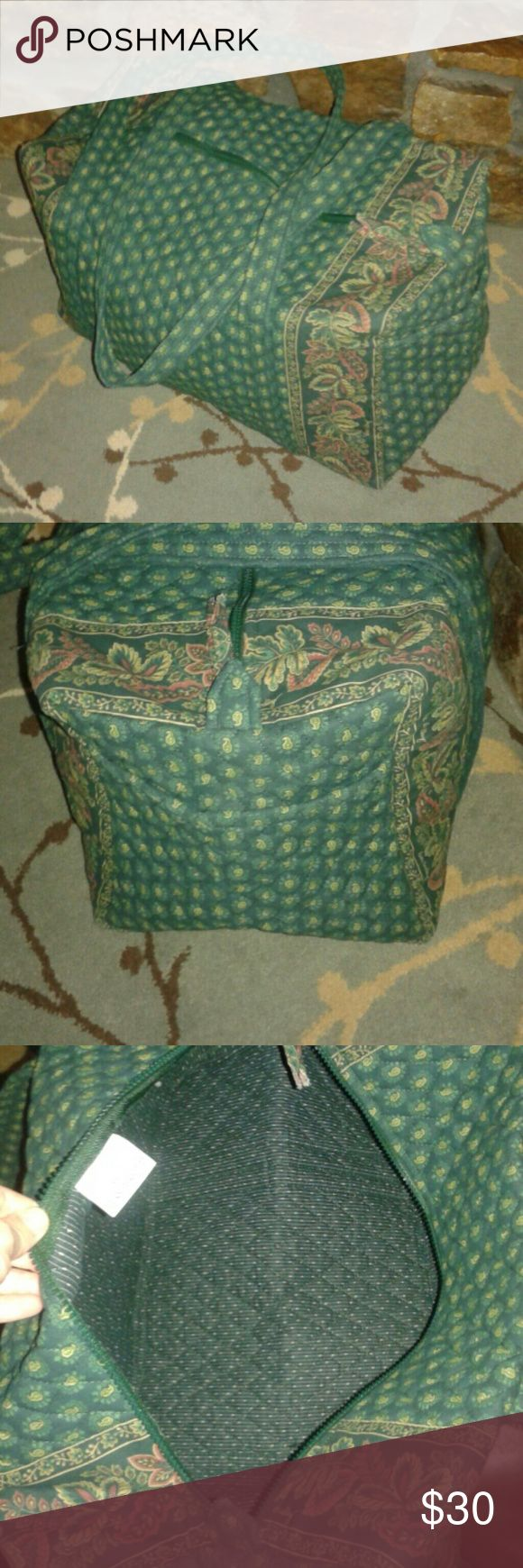 Vera Bradley extra large tote bag 19 x 10 x 11.  I don't believe this has ever been used. Like New inside and out. Large outside side pocket. Green paisley pattern. Vera Bradley Bags Totes
