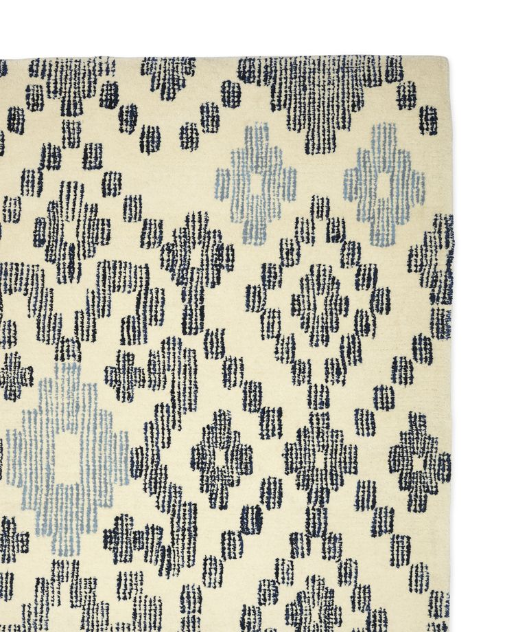Ready to join the ranks of iconic ikat, this geometric pattern has all the movement of its namesake. A soothing palette of blue and ivory softens the look.