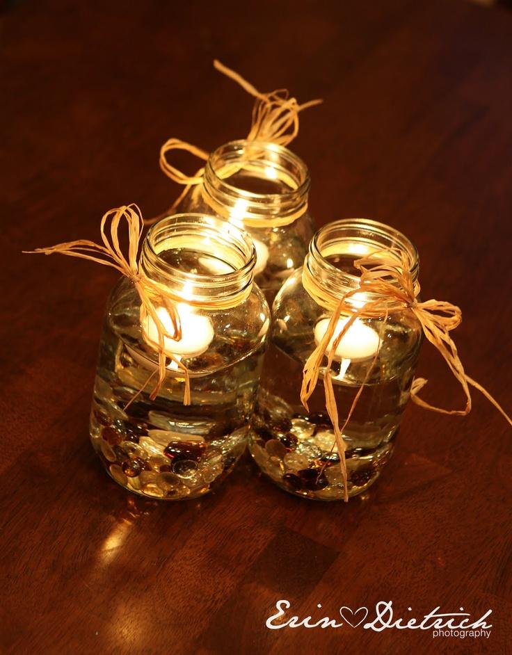 floating candles & brown rocks
