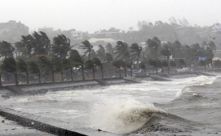 Strong winds and waves brought by Typhoon Hagupit pound the seawall in Legazpi City, Albay province southern Luzon December 7, 2014.