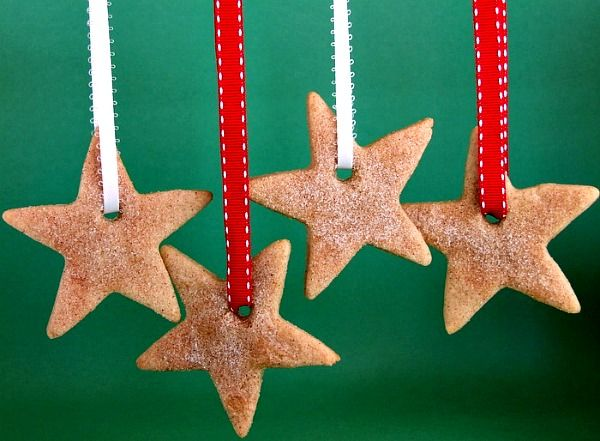 Fun cookie recipe for Cinnamon- Sugar Stars cut-out cookies.  Poke a little hole in the top, string them and hang them from your tree.  Photograph included.