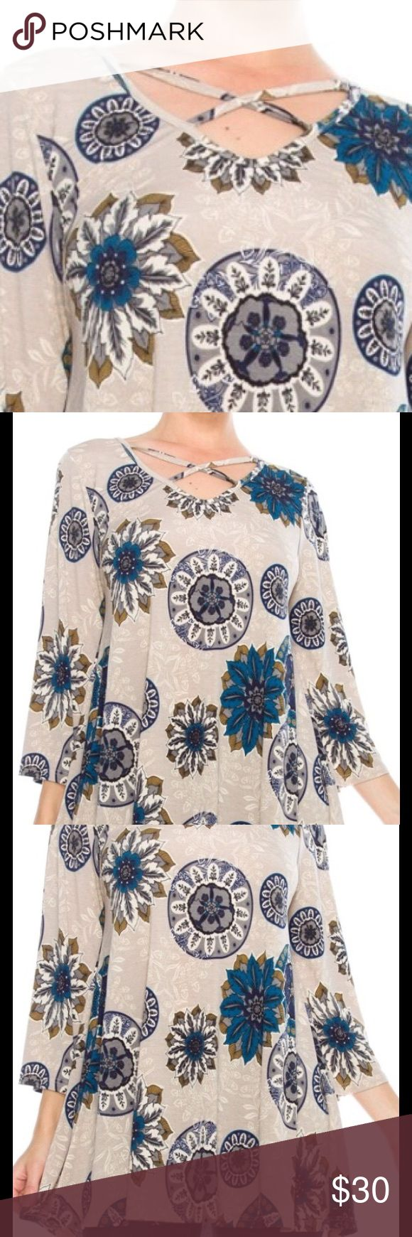 Brand New, Floral Tunic Brand New!!! Stone and teal colored floral top with cross front detail.  Looks great with navy or charcoal leggings. Tops