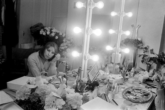 """Barbra Streisand in her dressing room at the Winter Garden in 1964, during her Broadway run in """"Funny Girl."""" Credit John Orris/The New York Times"""