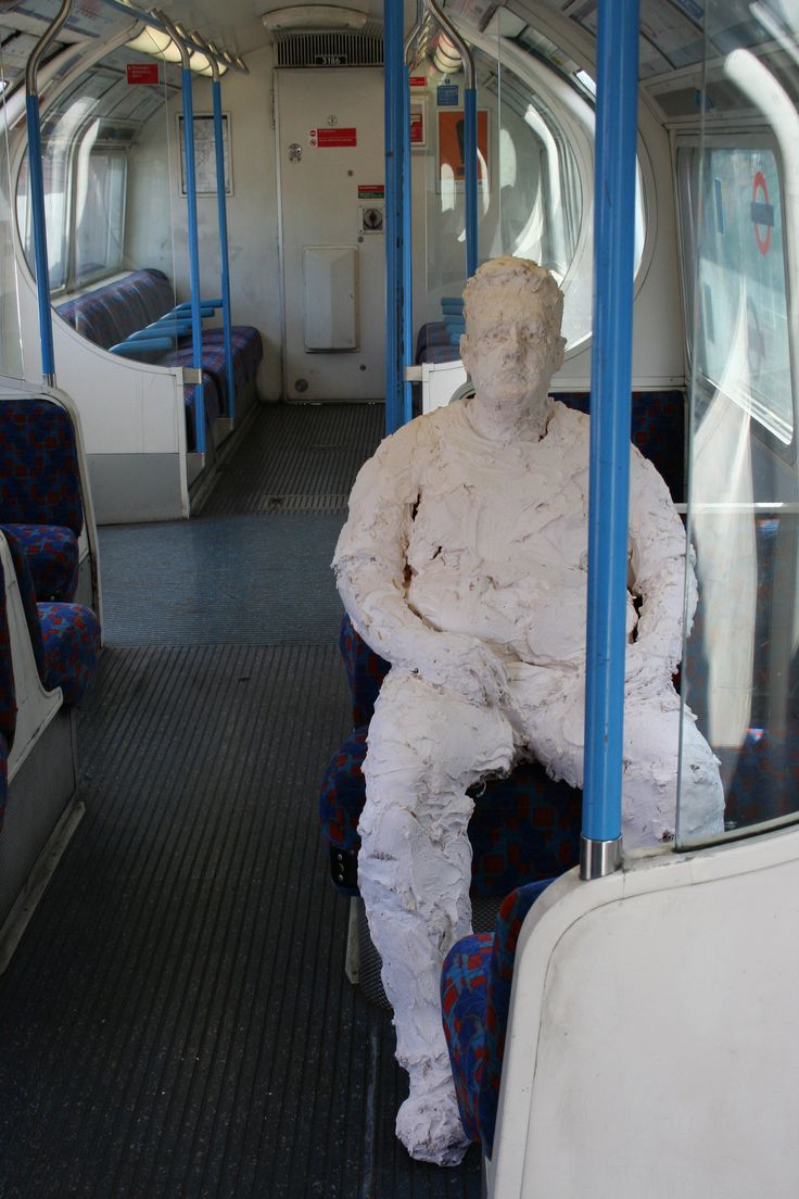 Waiting: life-size plaster sculpture on an underground train carriage