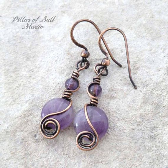 Handmade copper wire wrapped earrings. • Metal: solid copper, antiqued. • Stone: Amethyst. • Dimensions: They hang approximately 1 5/8 from the piercing. • Because each pair is handmade, please expect minor differences from those in the photos. **CARE TIPS: To help your copper