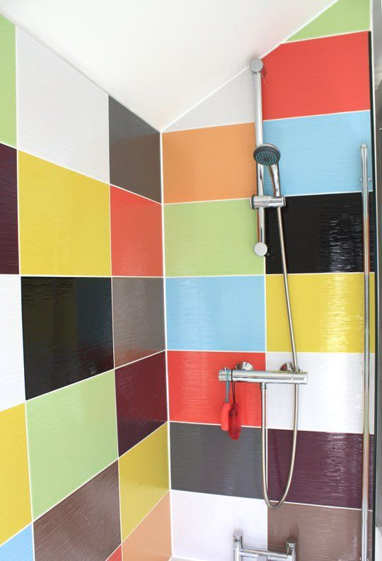 "Katie's ""Rainbow"" Room from Apt. Therapy. Colorful tiles in the shower/tub area and neutral light grey tiles in the rest. Fun but not overpowering."