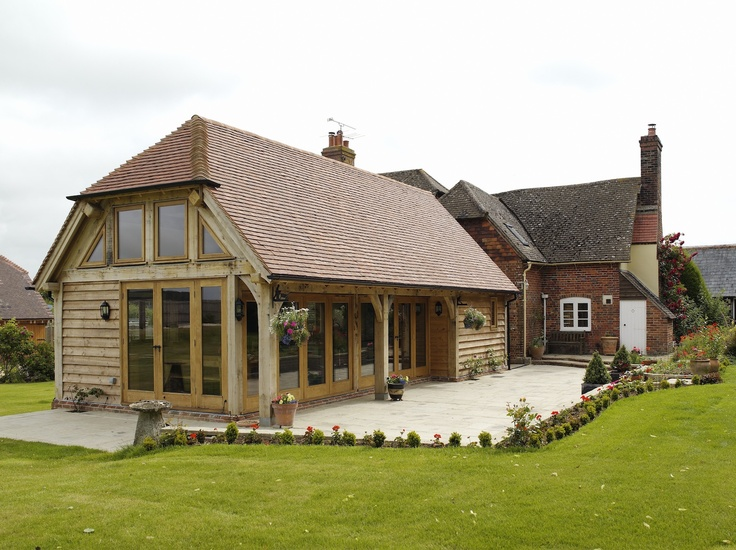 Border Oak - Oak framed kitchen extension with glazing and weatherboarded exterior.