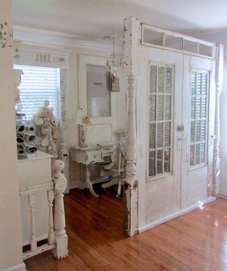 ❤️love this idea between living room an dining room Salvaged doors, windows and trim are used to divide a room - Junk Chic Cottage