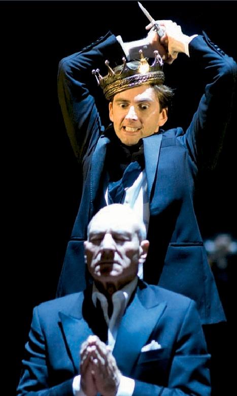 David Tennant as Hamlet, preparing to kill Claudius (Patrick Stewart), in a production of Hamlet .