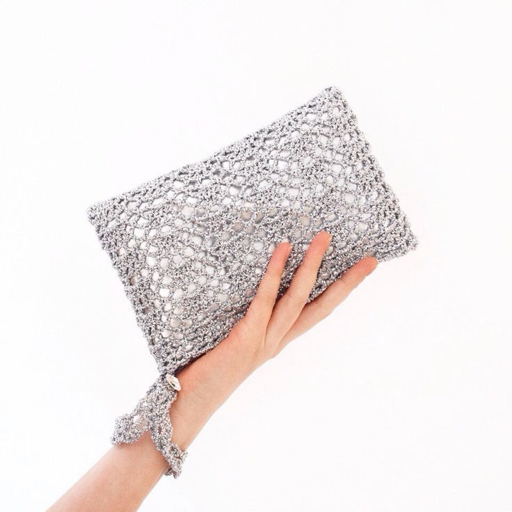 Testing a new shade of silver metallic clutch bag… :)