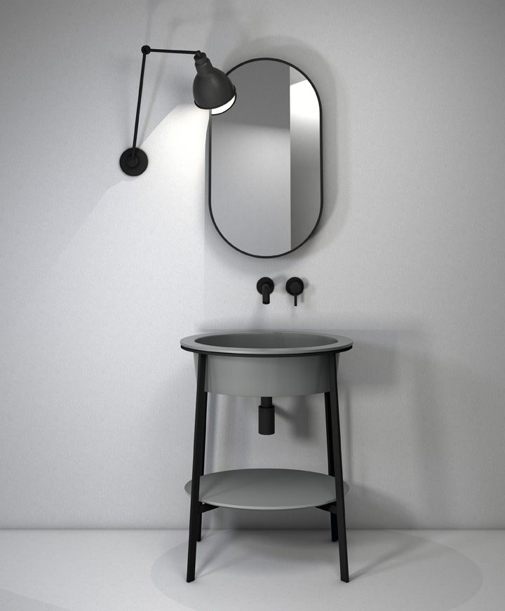Catino bathroom collection by CIELO with ceramic washbasin and top in the Frost finish, and an elegant steel structure with a matte black finish. Catino's design takes inspiration from the past to give a modern interpretation of one of the most iconic bathroom furnishing pieces of the early 20th century. Design by Andrea Parisio and Giuseppe Pezzano. #bathroomdesign #ceramic #interiordesign #HandMadeinItaly #Inspiration