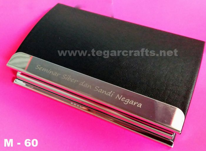 M-60: A Name card Holder  gift seminars ordered by Lembaga Sandi Negara Republic of Indonesia.       Various collection of name card holder options, using soft synthetic leather, can be used to store your business cards. Ideal as an executive gift or gift for professionals. We offer additional printed logo or your company name with laser engraving or screen printing technique. So you can make exclusive gifts, stylish and highly appreciated-for professionals in your life.