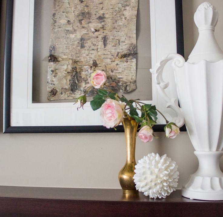 framed birchbark in a vignette with brass vase with roses