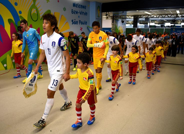 Koo Ja-Cheol of South Korea leads his teammates on to the pitch in the tunnel prior to the 2014 FIFA World Cup Brazil Group H match between Korea Republic and Belgium at Arena de Sao Paulo on June 26, 2014 in Sao Paulo, Brazil. (Photo by Jeff Mitchell - FIFA/FIFA via Getty Images)