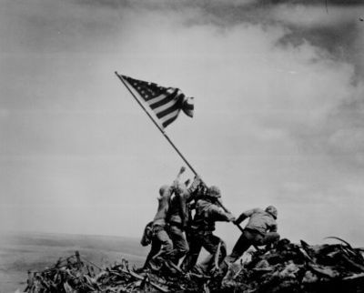 Raising the Flag on Iwo Jima is a historic photograph taken on February 23, 1945, by Joe Rosenthal. It depicts five United States Marines and a U.S. Navy corpsman raising the flag of the United States atop Mount Suribachi[1] during the Battle of Iwo Jima in World War II. (Joel Rosenthal)