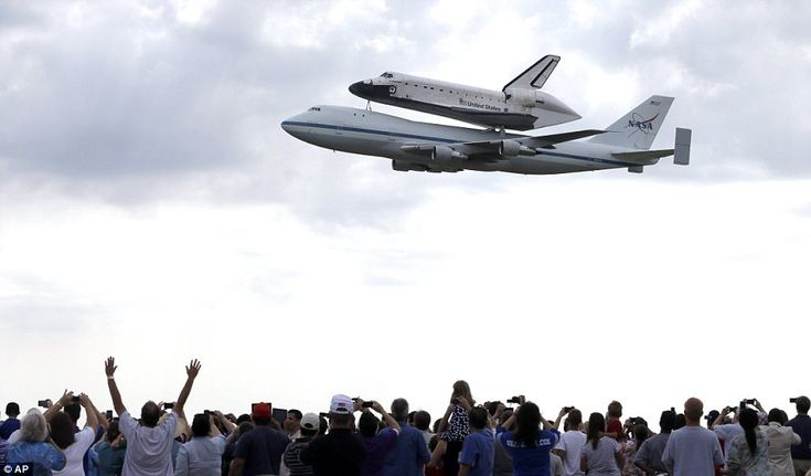 Hero's welcome: Space Shuttle Endeavour flies over Ellington Field in Houston just before landing on Wednesday