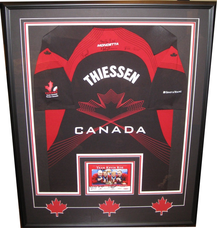 Team Canada curling jersey from Kevin Koe's World Curling Championship team. Framed up for customer with photo and custom cut maple leaf mat.