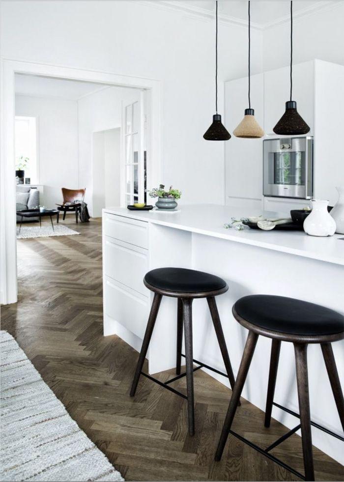 mater stools. white kitchen. herringbone floors...