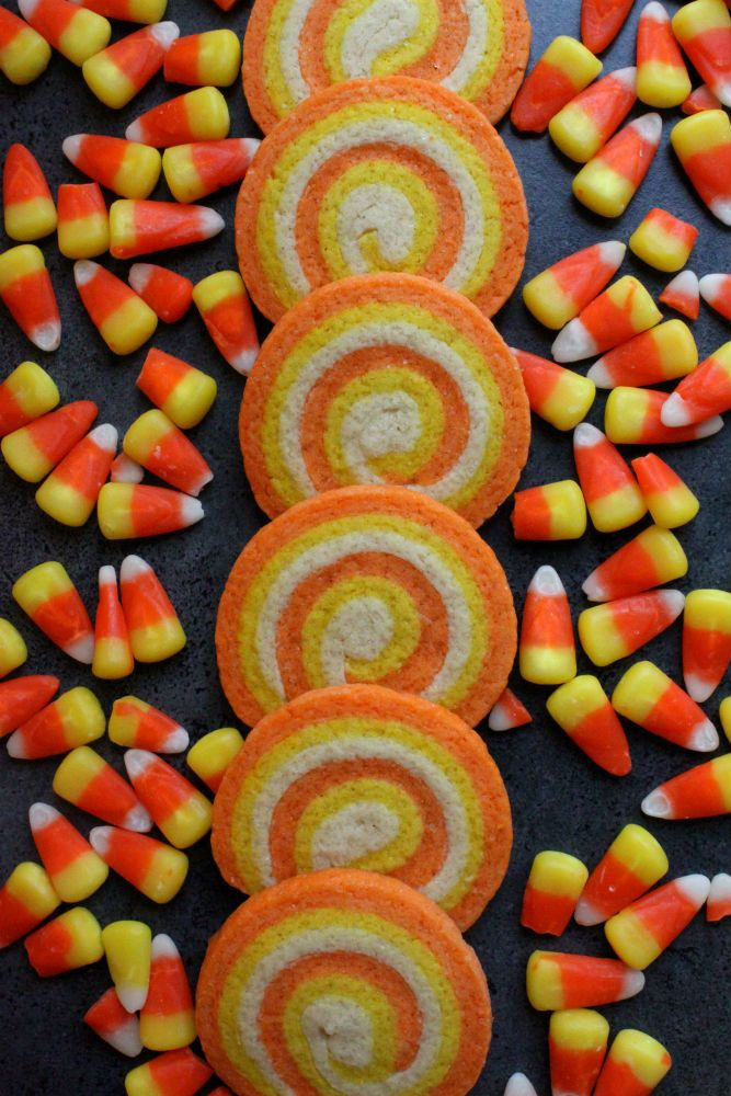 Halloween candy corn cookies 2 sticks (226 grams) butter, softened 1 cup granulated sugar 1 large egg 1 tsp. baking powder 1 tsp. vanilla extract 2 1/2 cups all purpose flour Food coloring in yellow and orange: