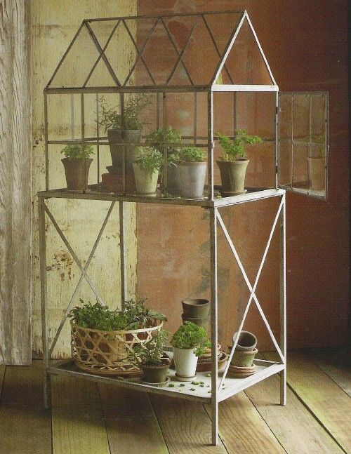 Cute little greenhouse for on a patio or deck.