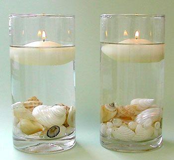 Velas no fundo do copo podera ser colocado flores