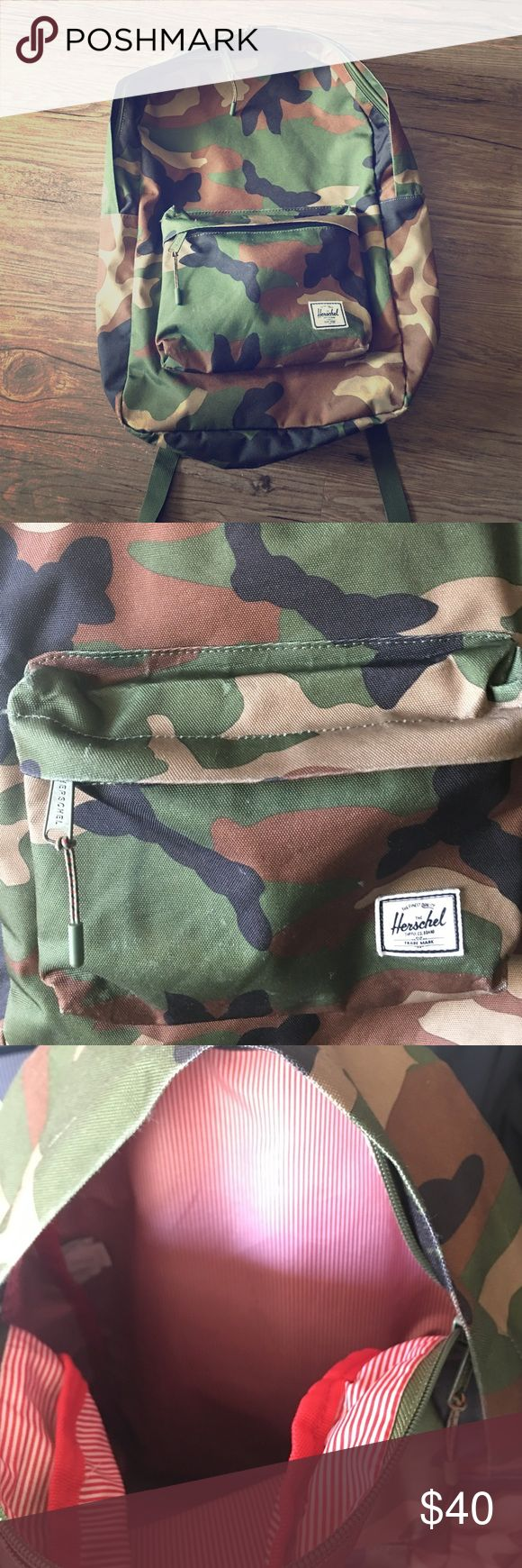 """Herschel Camo Bookbag DETAILS The Herschel Classic™ backpack stays true to its timeless design, offering a clean and simple silhouette that is perfectly tailored to fit your style.  Signature striped fabric liner Front storage pocket Prusik cord zipper pulls Classic woven label DIMENSIONS 18""""(H) x 12.25""""(W) x 5""""(D), 22L Bags Backpacks"""