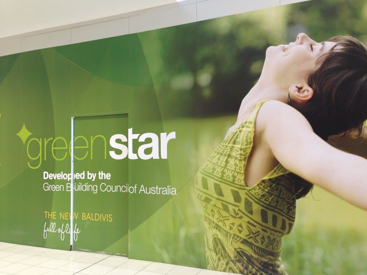 Stockland shout about their Green Star rating on hoardings around the Baldivis shopping centre.