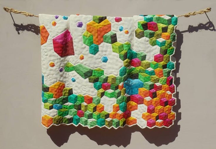 Different Tumbling Blocks by Fraser Smith/Sculpture  This is carved and painted wood
