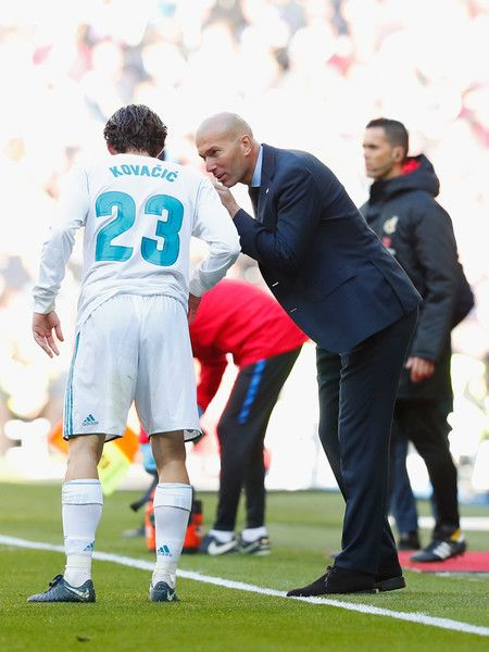 Zinedine Zidane, Manager of Real Madrid gives instructions to Mateo Kovacic of Real Madrid during the La Liga match between Real Madrid and Barcelona at Estadio Santiago Bernabeu on December 23, 2017 in Madrid, Spain.