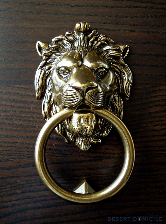 look for less lion head door knocker