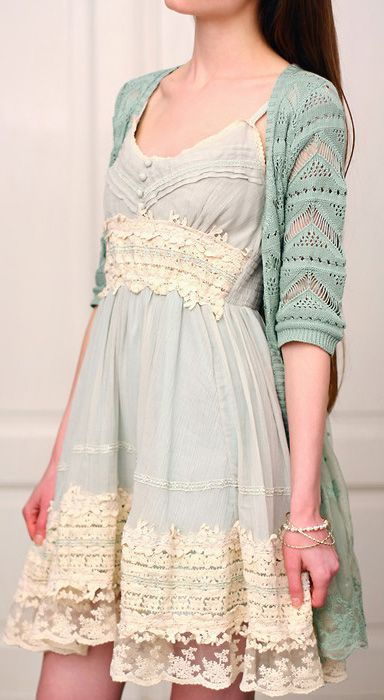 Delicate on delicate. Muted turquoise, powder whites... intricate, lace sweater over dress.