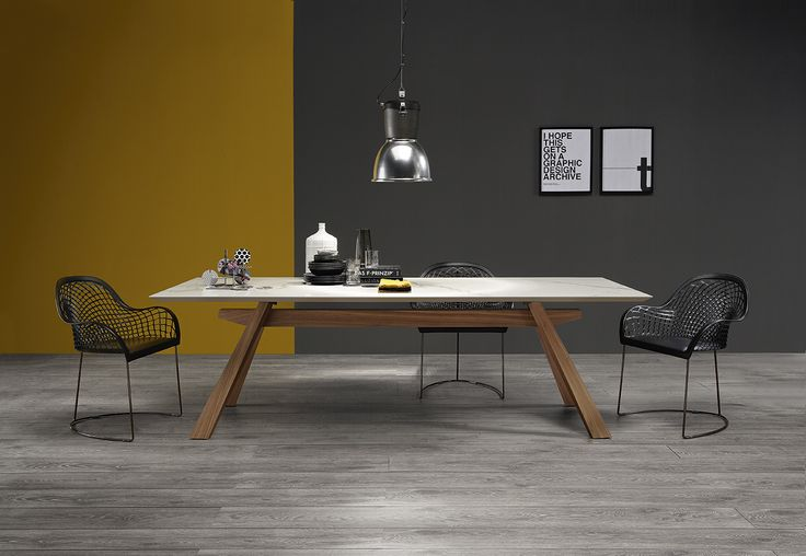Zeus fix and extendable table by Midj in Italy, is inspired by the simple but genius refectory table used in ancient monastery. The result is a modern and elegant restyling of the original model: it maintains the structural wooden characteristics but increased the contemporary design which makes it suitable for living rooms.
